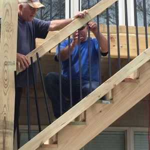 Dustin working with his father on new deck