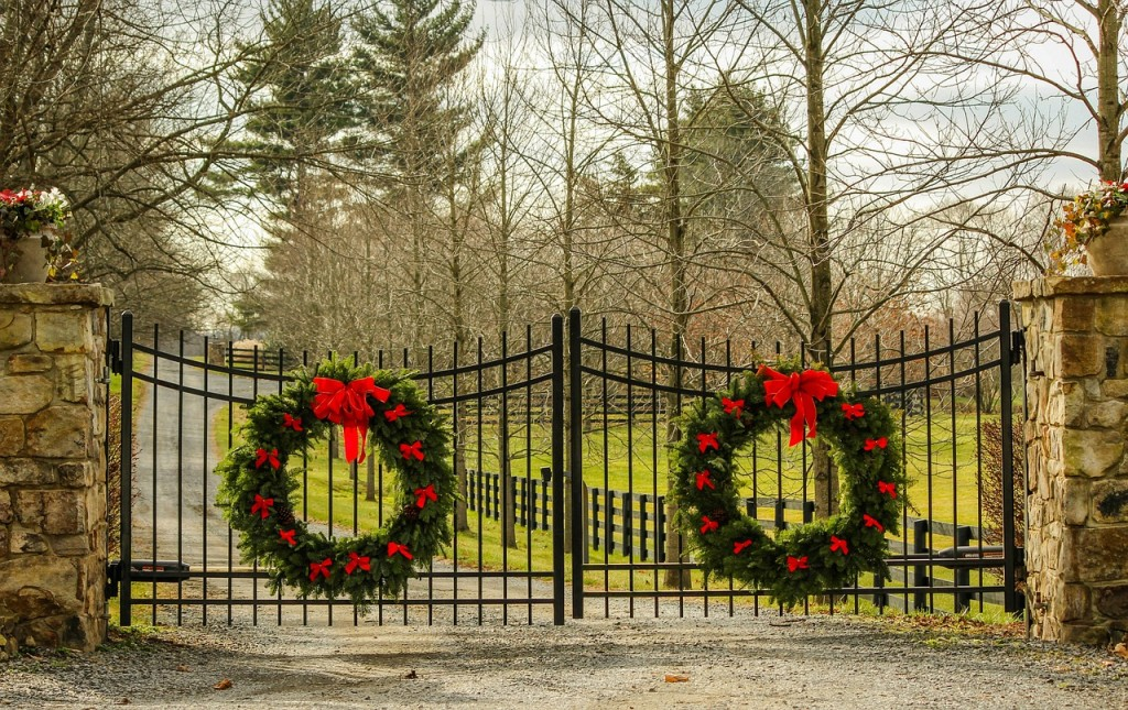 Christmas Wreaths on driveway steel gate with stone posts